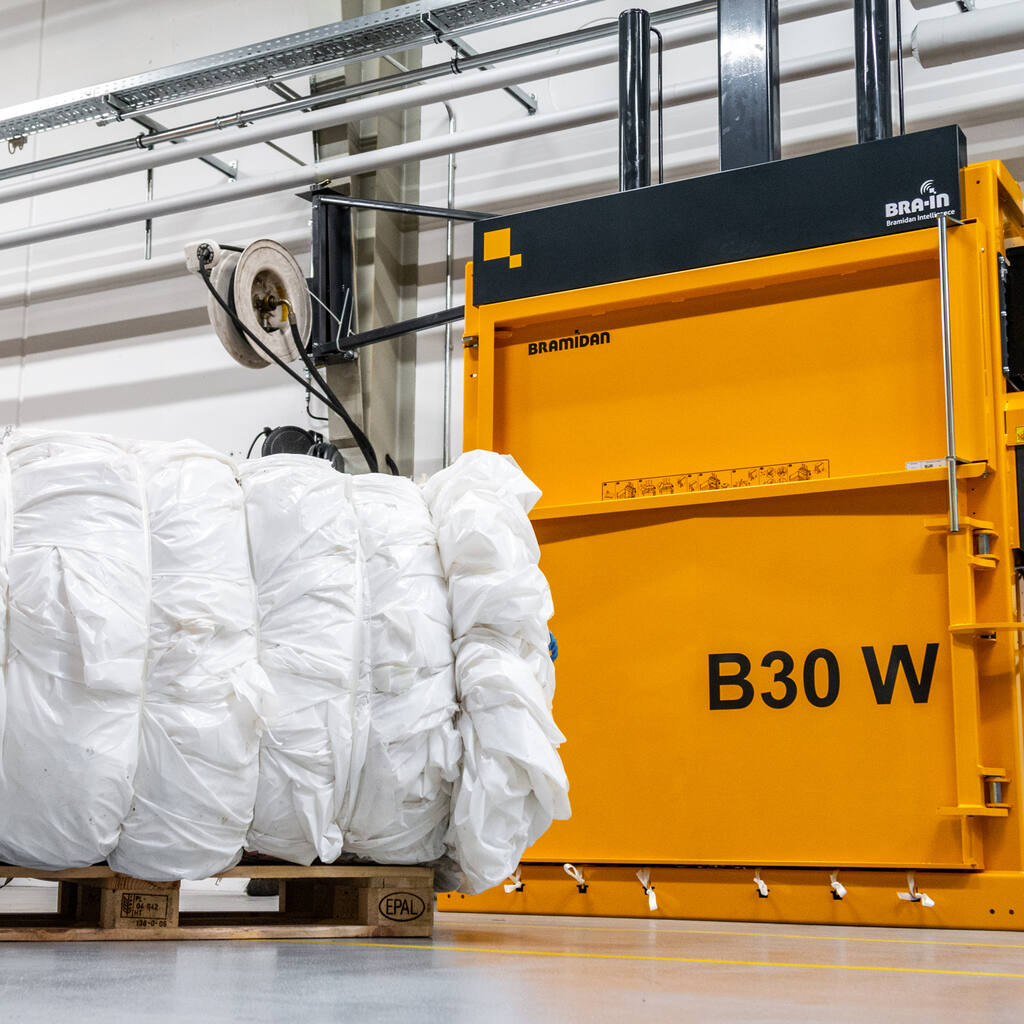 No7-B30-Wide-baler-with-plastic-bale-in-front-1500x1500.jpg